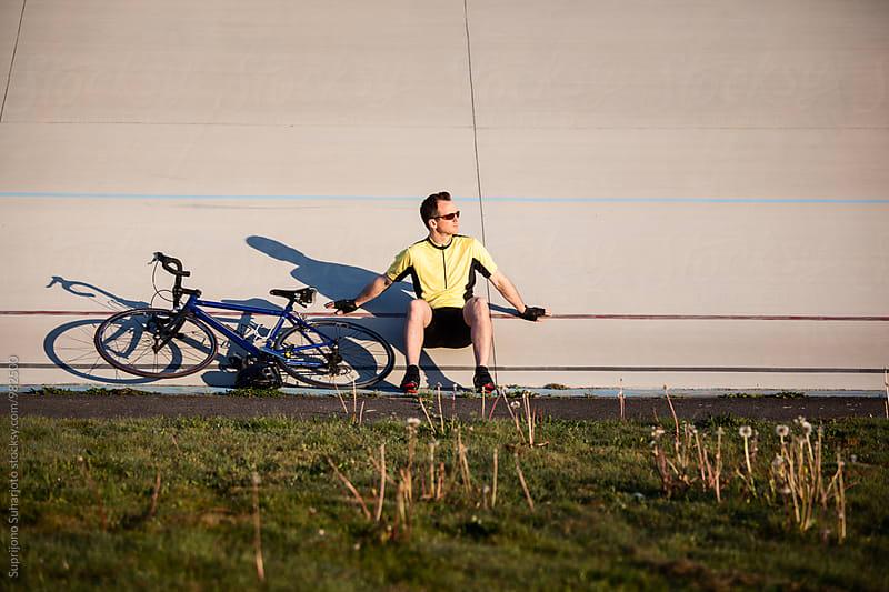 Cyclist training in a velodrome by Suprijono Suharjoto for Stocksy United