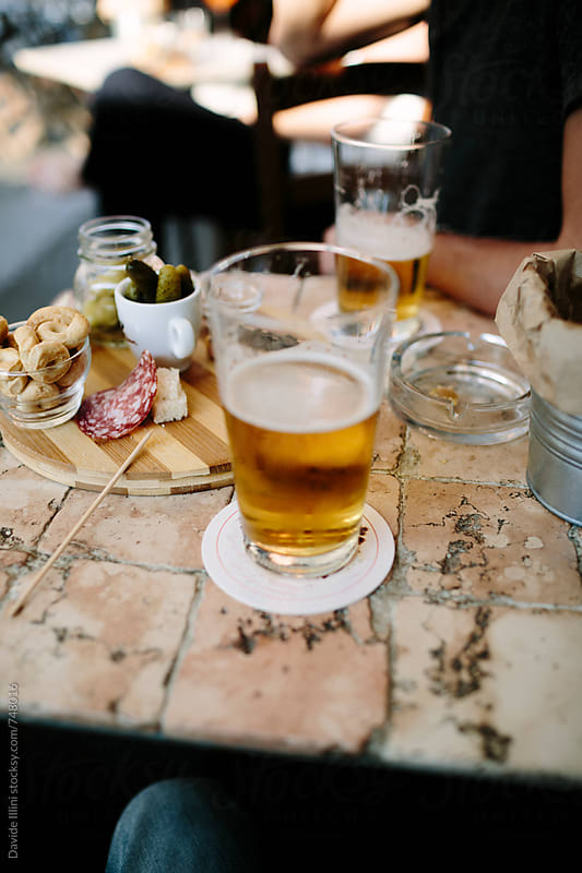 Beer on a table in a cafe by Davide Illini for Stocksy United