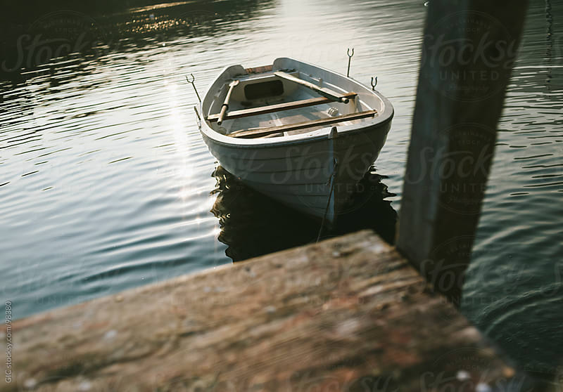 Wooden boat floating in the lake by GIC for Stocksy United