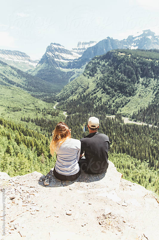 Couple Looking Out at Mountains by Jake Elko for Stocksy United