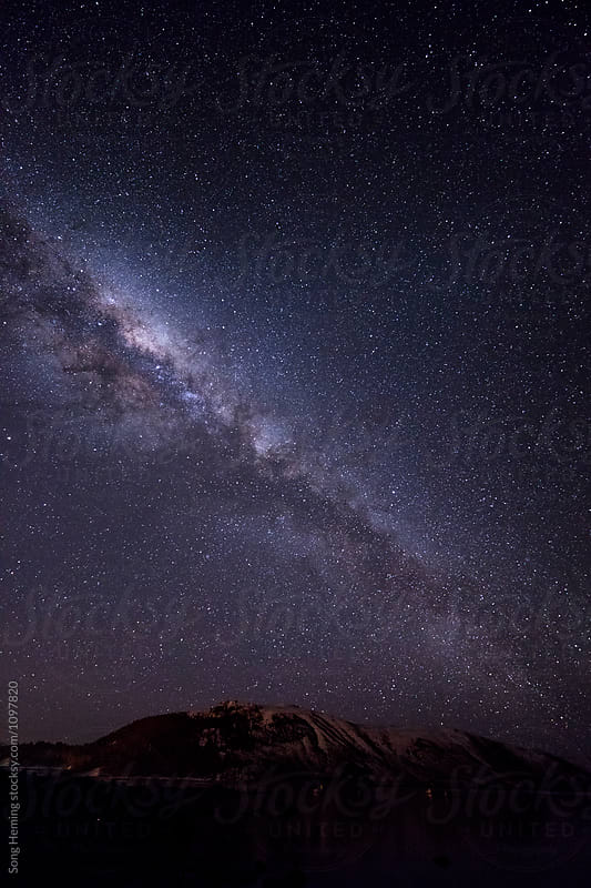 Landscape with mountains and milky way at night by Song Heming for Stocksy United
