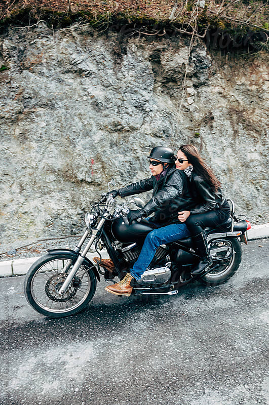 Couple on motorcycle by Dimitrije Tanaskovic for Stocksy United