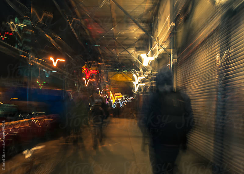 People walking . City background at night by Gabriel Diaz for Stocksy United