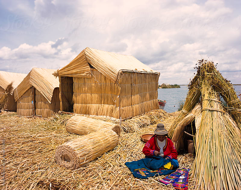 Woman in traditional costume on the Uros islands. Puno. Peru. by Hugh Sitton for Stocksy United