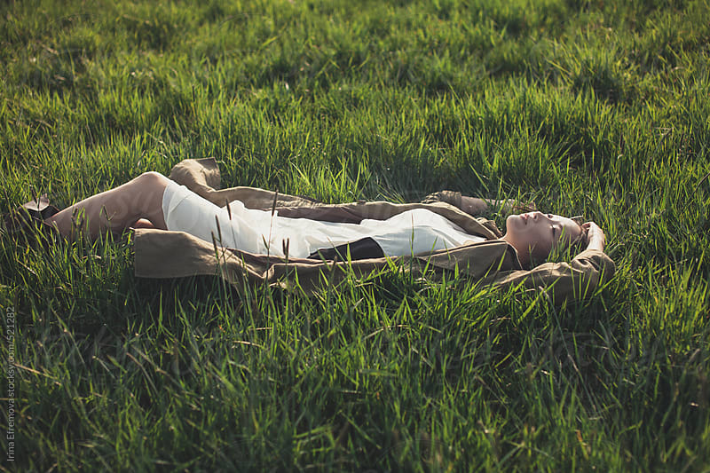 Asian girl on the grass by Irina Efremova for Stocksy United