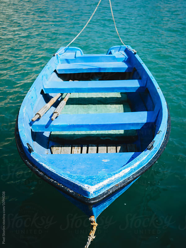 Blue boat moored with ropes by Pixel Stories for Stocksy United