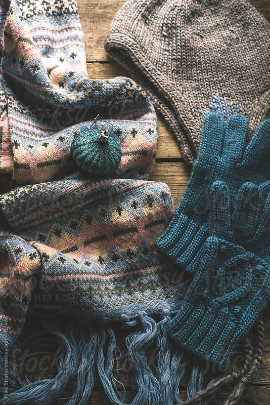 Wool winter-themed hat, sweater and gloves by Pixel Stories for Stocksy United