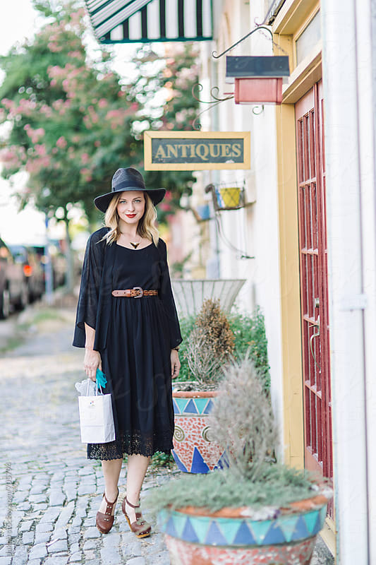 Beautiful woman shopping outside by Jakob for Stocksy United