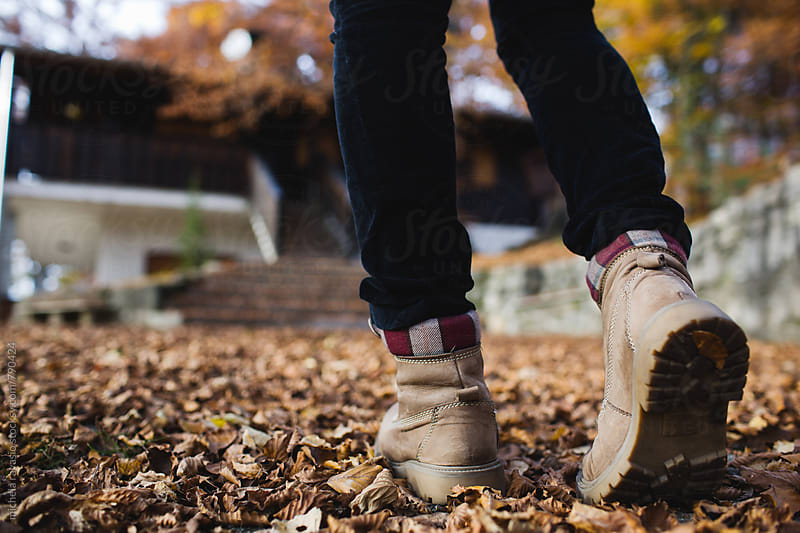 Walking on a carpet of leaves by michela ravasio for Stocksy United