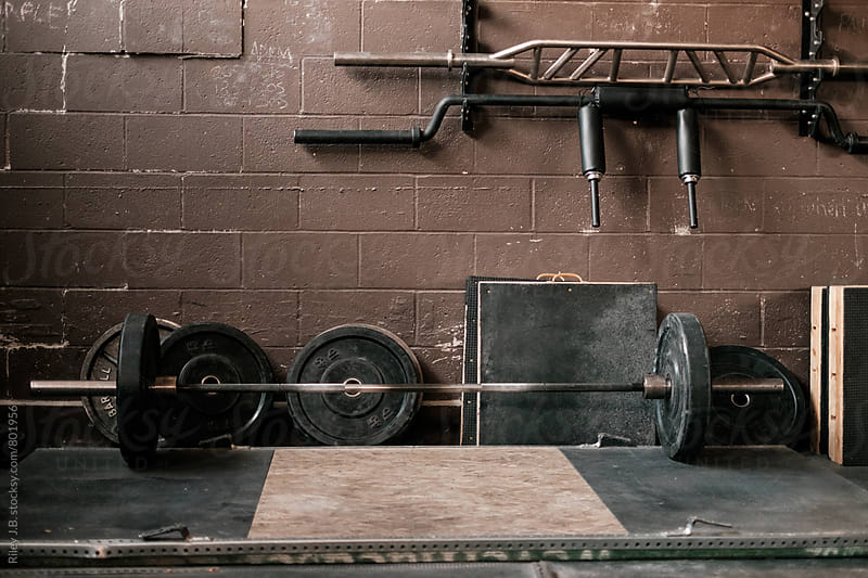 A weighted barbell on the floor by Riley J.B. for Stocksy United