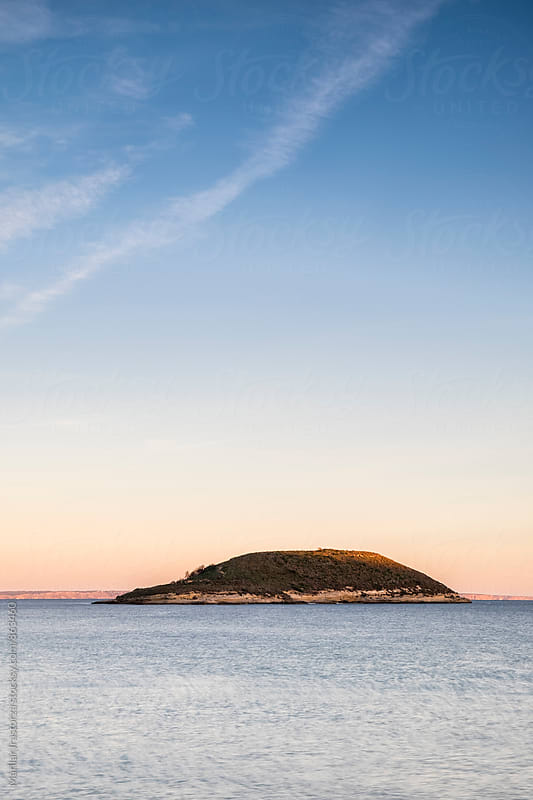 Small island off the coast of Mallorca at sunset by Marilar Irastorza for Stocksy United