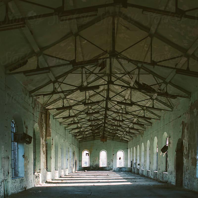 Empty factory hall by Branislav Jovanović for Stocksy United
