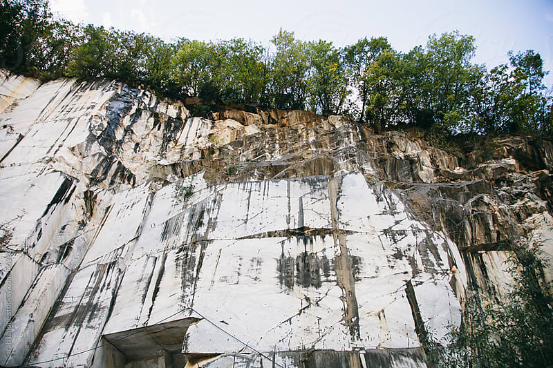 Face of a mountain mined for marble in Cararra, Italy by Sarah Lalone for Stocksy United