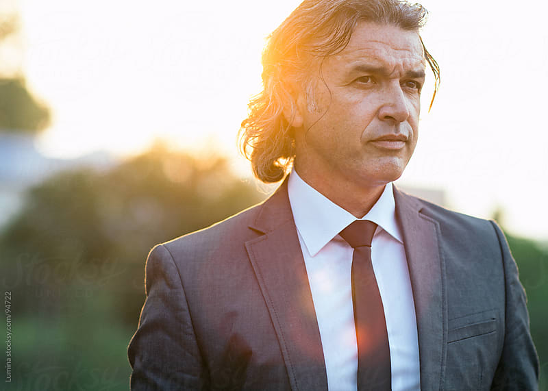 Outdoor Portrait of a Caucasian Businessman by Lumina for Stocksy United