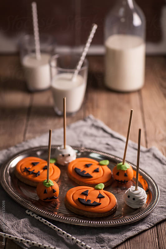 Pumpkin Shaped Cookies and Milk by Mosuno for Stocksy United