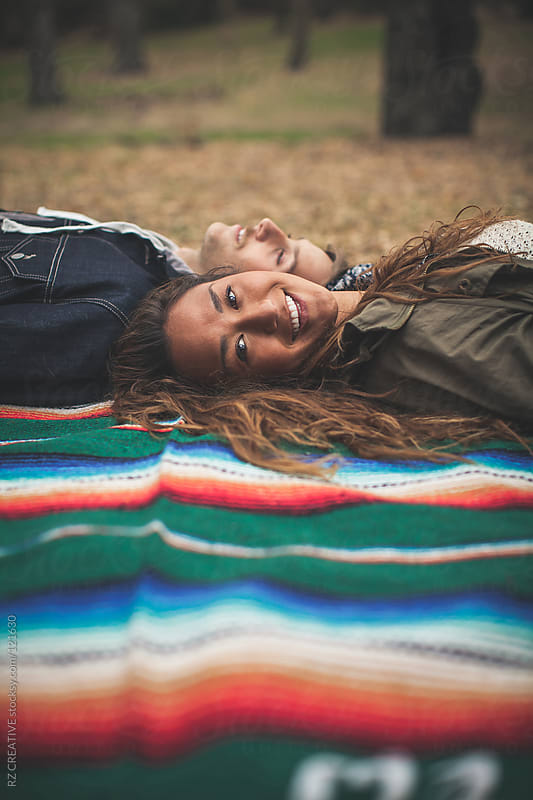 Attractive young couple with woman smiling facing camera. by RZ CREATIVE for Stocksy United