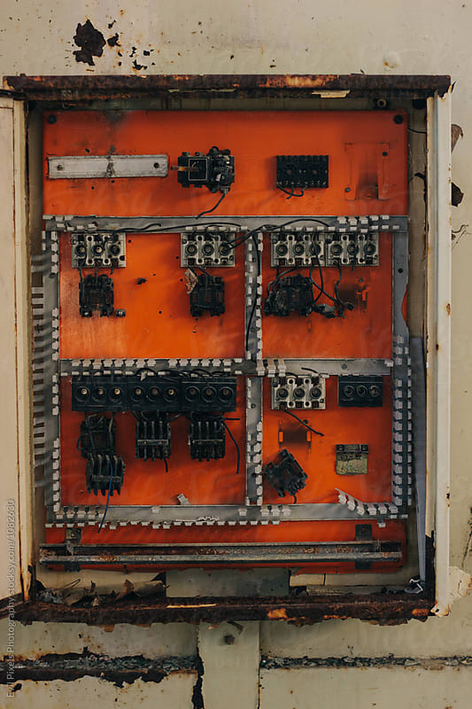 Broken fuse box in abandoned factory by Branislava Živić for Stocksy United