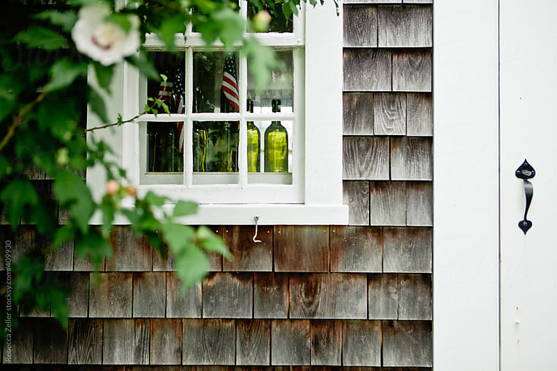 the exterior of a shingled house on the island of martha's vineyard by Rebecca Zeller for Stocksy United