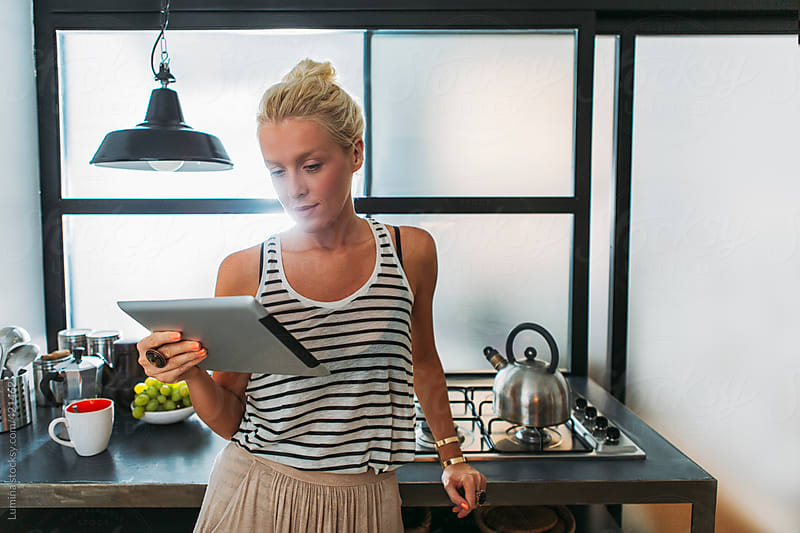 Blonde Woman With a Tablet in the Kitchen by Lumina for Stocksy United
