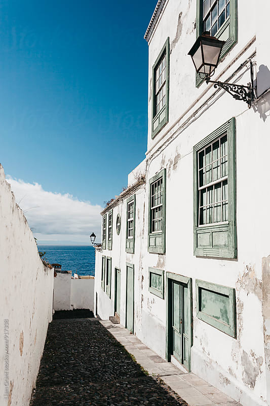 White building and alleyway in Santa Cruz. La Palma, Canary Islands. by Liam Grant for Stocksy United