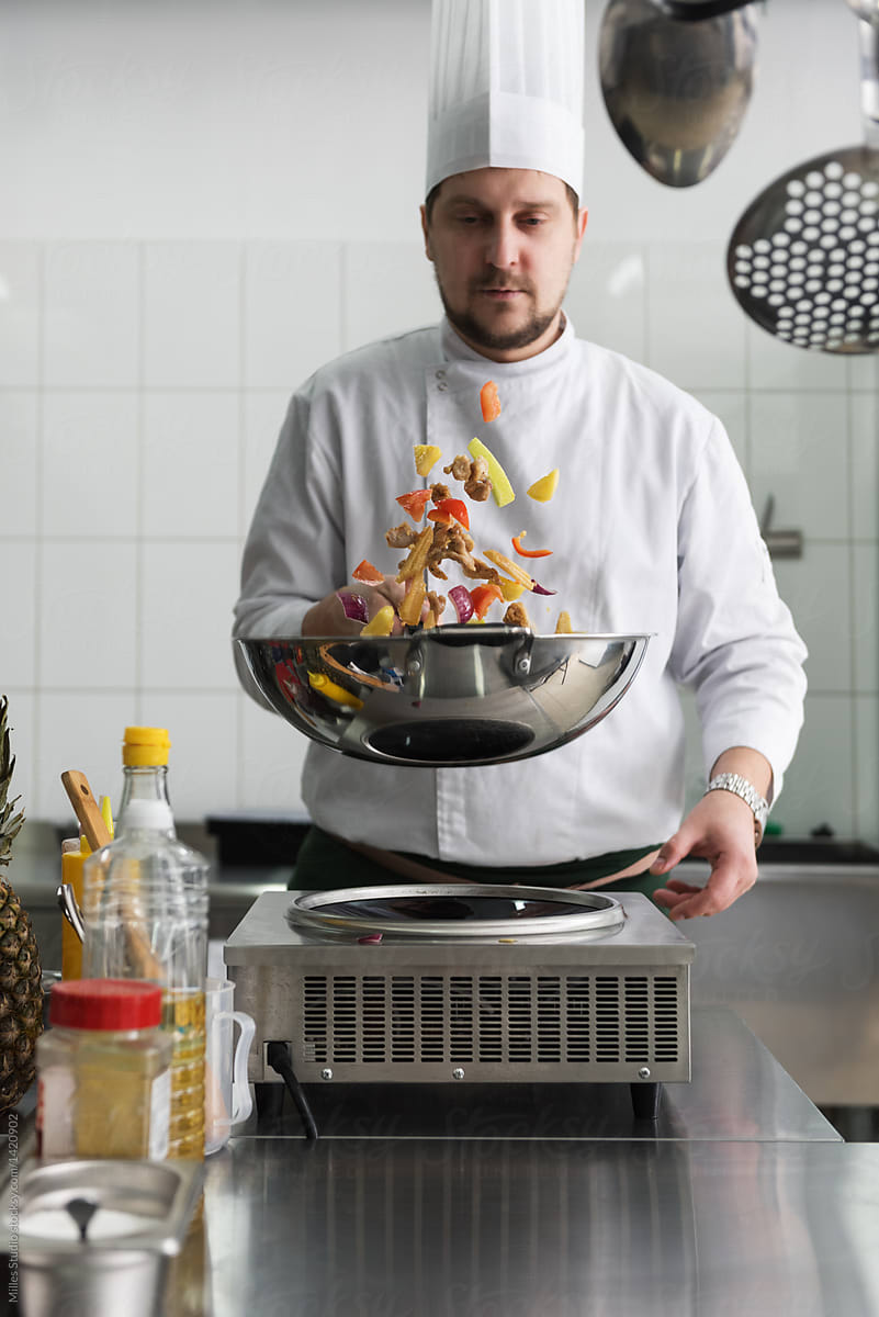 Chief Cooking With Wok In Kitchen By Milles Studio Wok Cooking