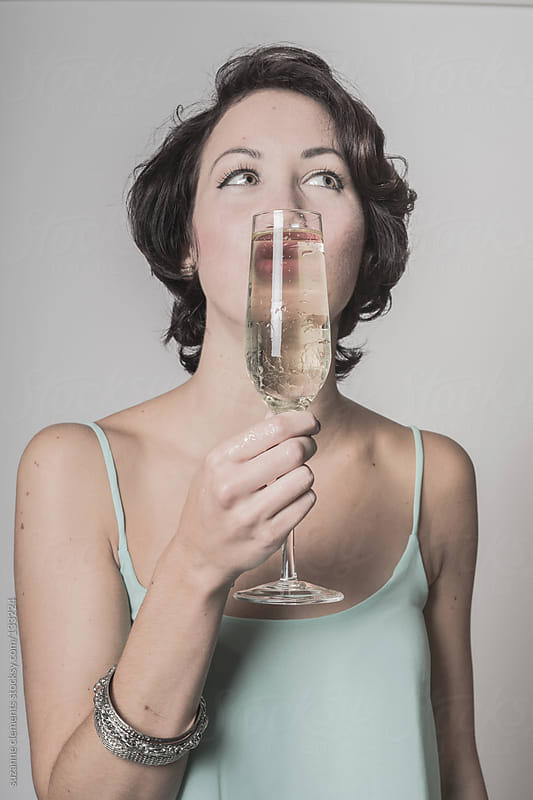 Pretty Woman Goofing around with her Drink by suzanne clements for Stocksy United