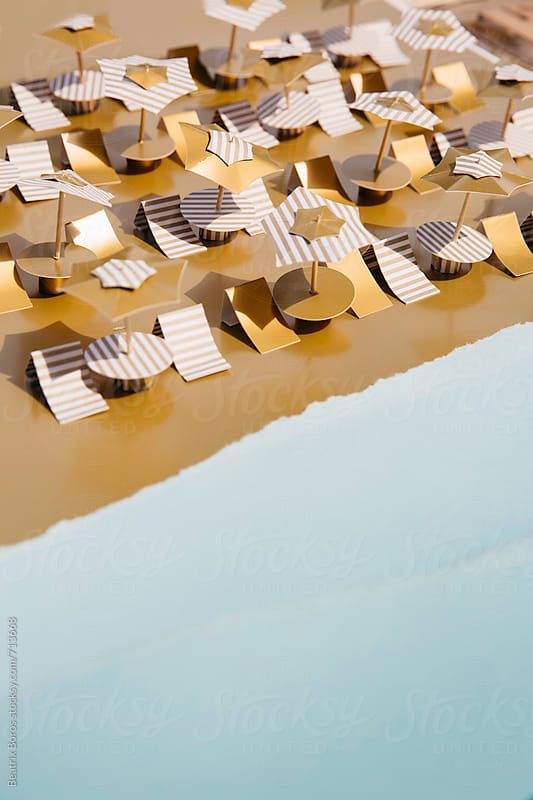 Concept of sandy beach and the sea made of paper by Beatrix Boros for Stocksy United