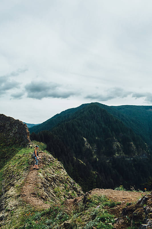 Woman Hiker Standing on Mountain Ridge by Evan Dalen for Stocksy United
