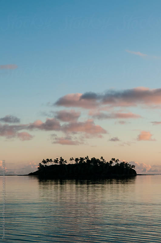 Tropical island at sunset, Rarotonga Island, Cook Islands. by Thomas Pickard for Stocksy United