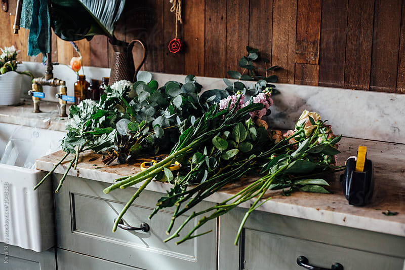 Cut Flowers on Florists Bench by Kara Riley for Stocksy United