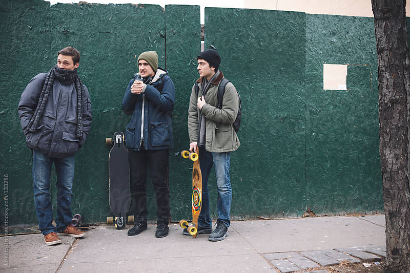 Young Men Friends Hanging Out in Brooklyn on a Weekend by Joselito Briones for Stocksy United