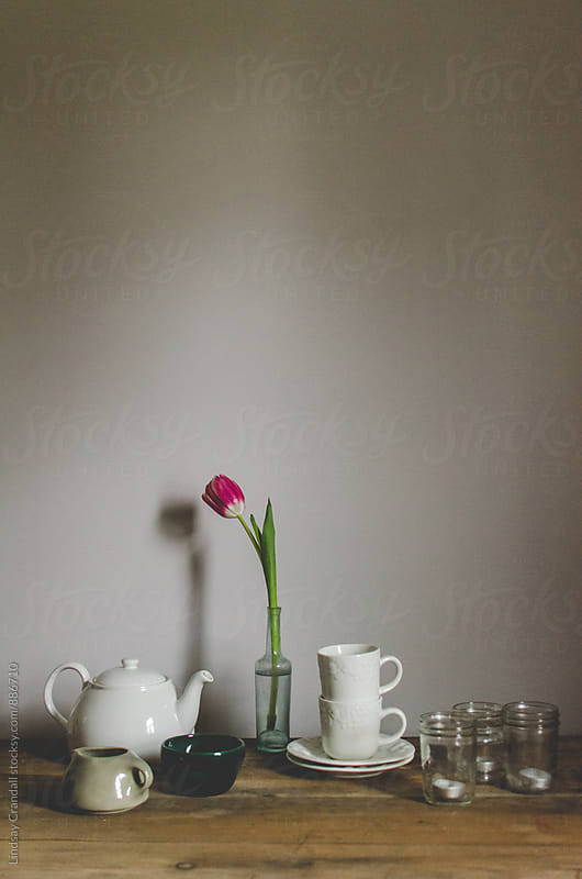 Table with empty teacups, waiting for tea to be poured by Lindsay Crandall for Stocksy United