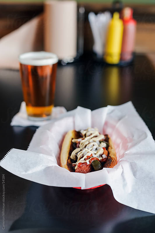 Bar Food: Hot Dog with grilled veggies and mustard sauce by Cameron Whitman for Stocksy United