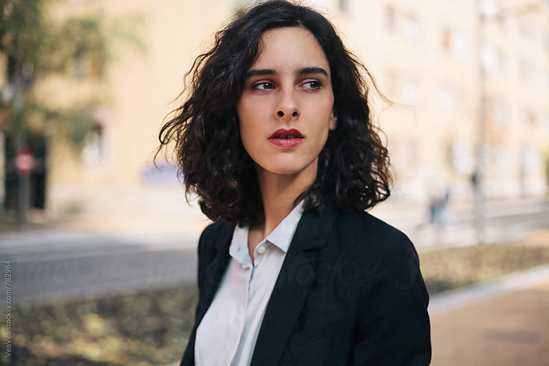 Portrait of a beautiful woman in suit on the street  by Marija Mandic for Stocksy United