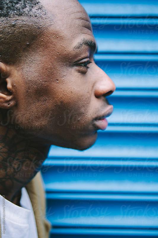 Tattooed man portrait by kkgas for Stocksy United