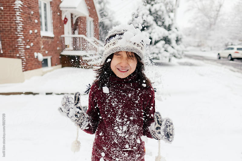 Young Boy Gets Hit With Snow by Kelli Seeger Kim for Stocksy United