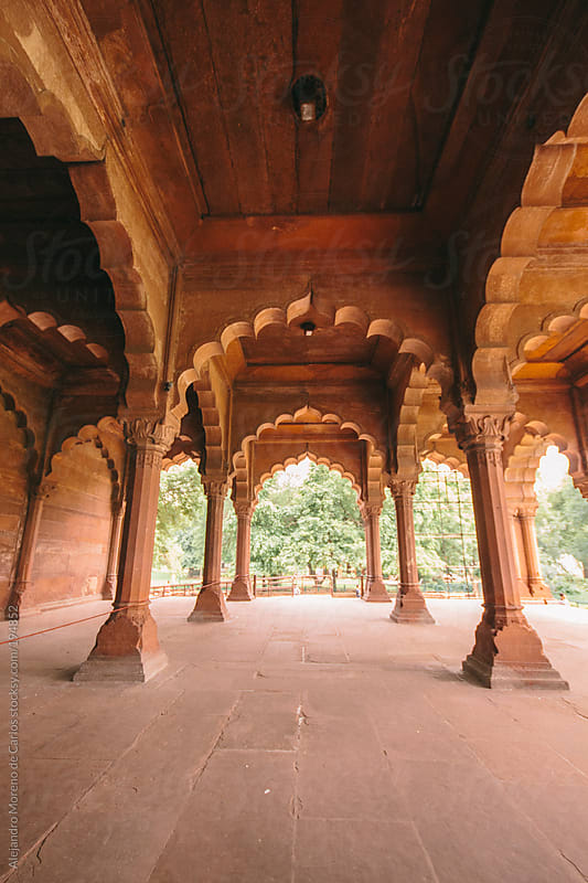 Arches and columns on India fort - palace. Red fort, Delhi, India by Alejandro Moreno de Carlos for Stocksy United