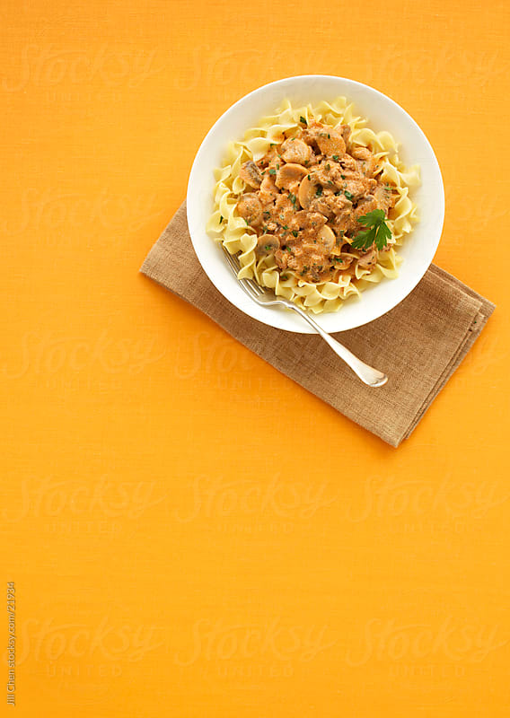 Pasta on Orange by Jill Chen for Stocksy United
