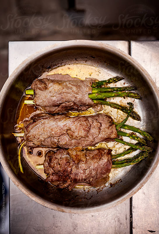 Meat with asparagus by MEM Studio for Stocksy United