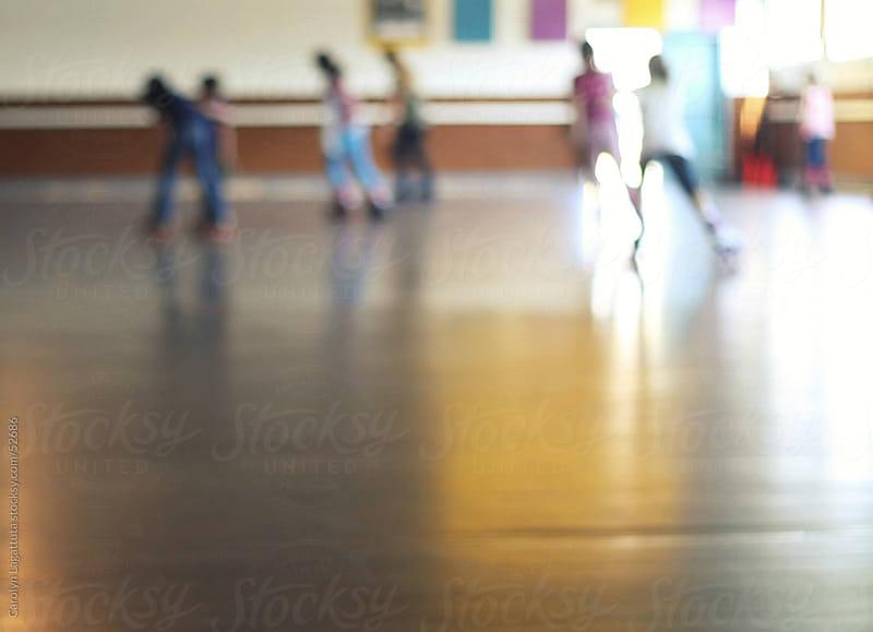Blur of people roller skating  by Carolyn Lagattuta for Stocksy United