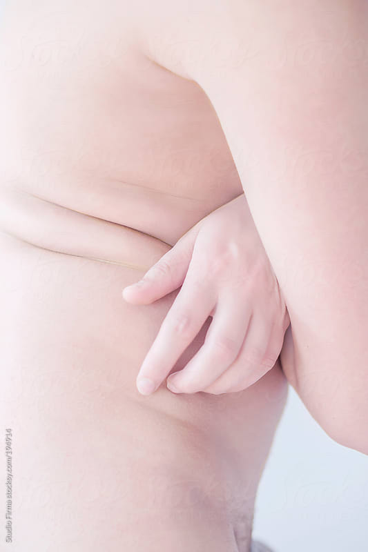 Side view of a nude human abdomen by Studio Firma for Stocksy United