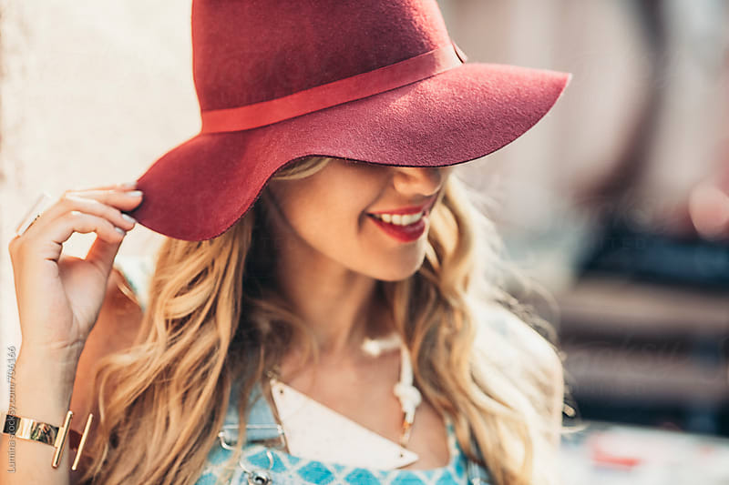 Woman With a Red Hat by Lumina for Stocksy United