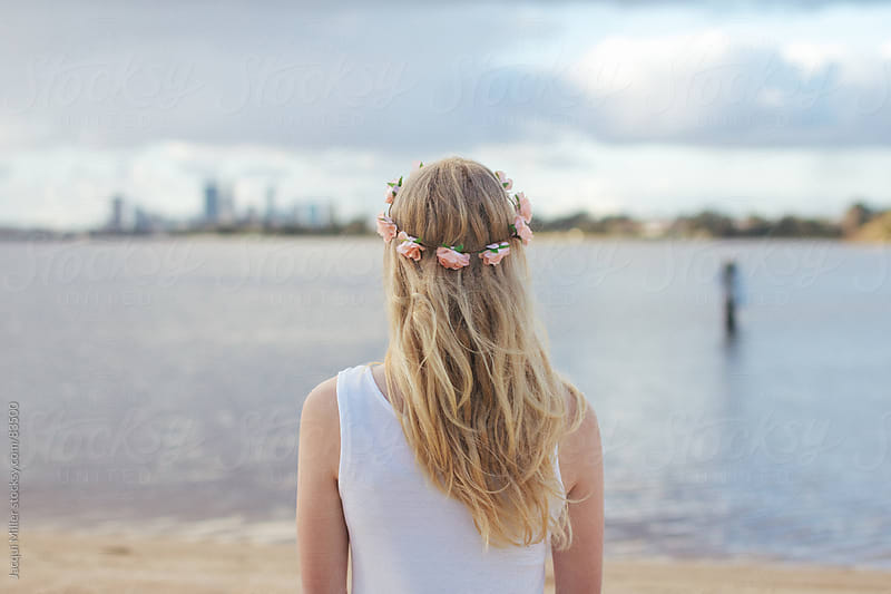 Girl with a floral wreath on her head by Jacqui Miller for Stocksy United