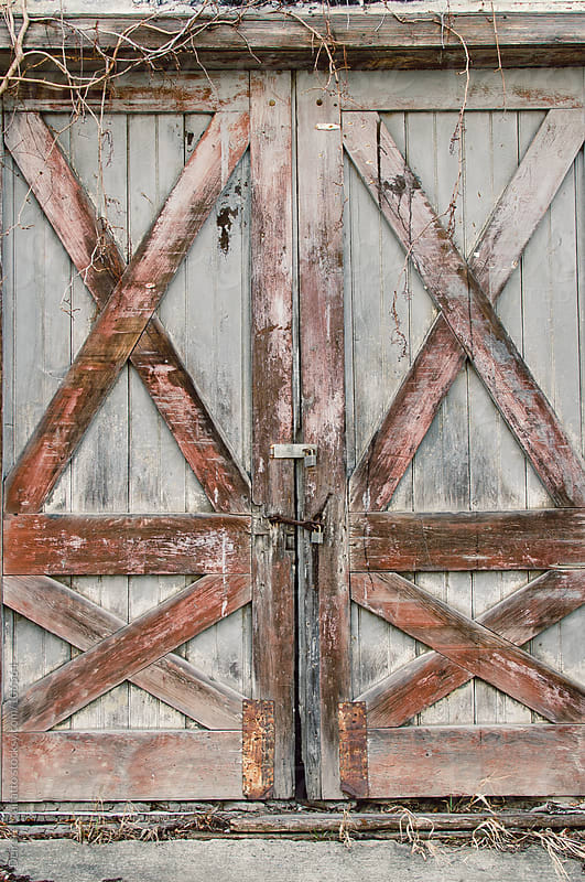 doors of an old barn by Deirdre Malfatto for Stocksy United