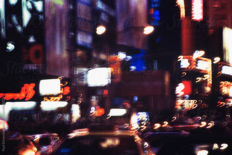 Blurred nighttime view of traffic and lights in Times Square, NY, NY, USA by Paul Edmondson for Stocksy United