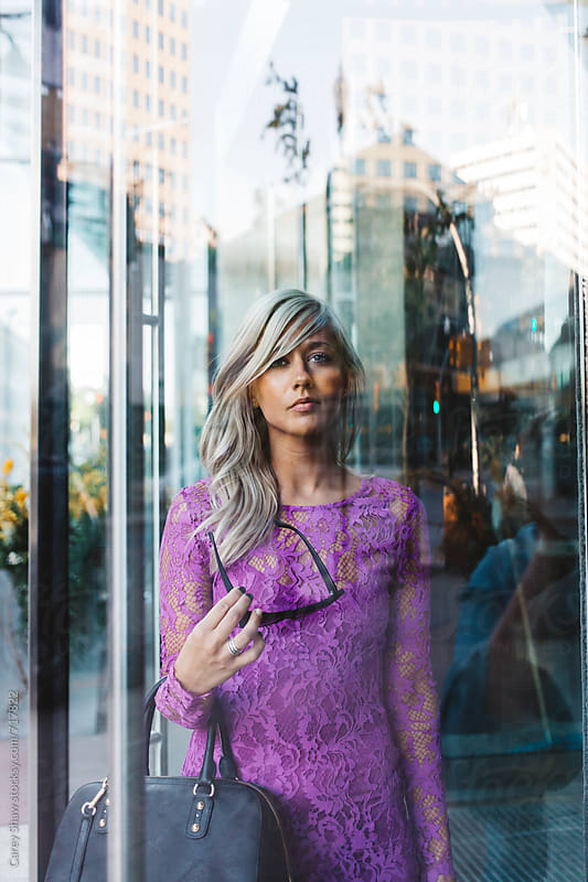 Beautiful stylish woman standing behind glass door by Carey Shaw for Stocksy United