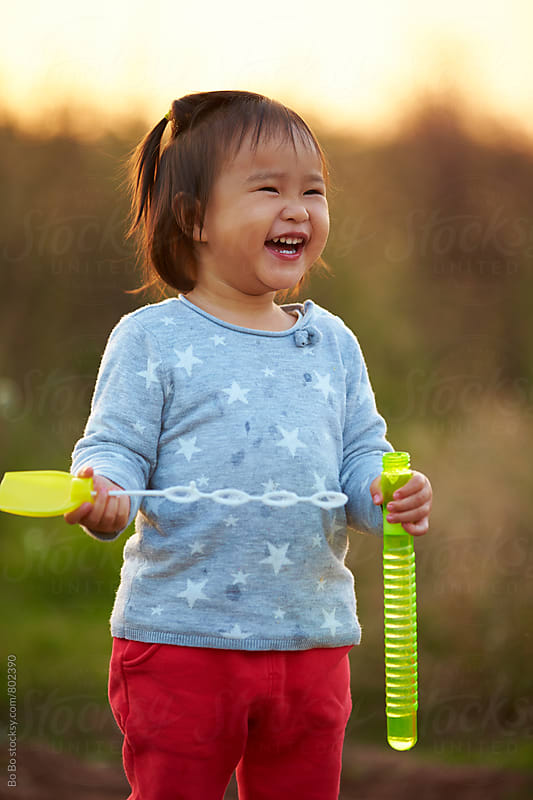 happy little girl playing bubble outdoor by Bo Bo for Stocksy United