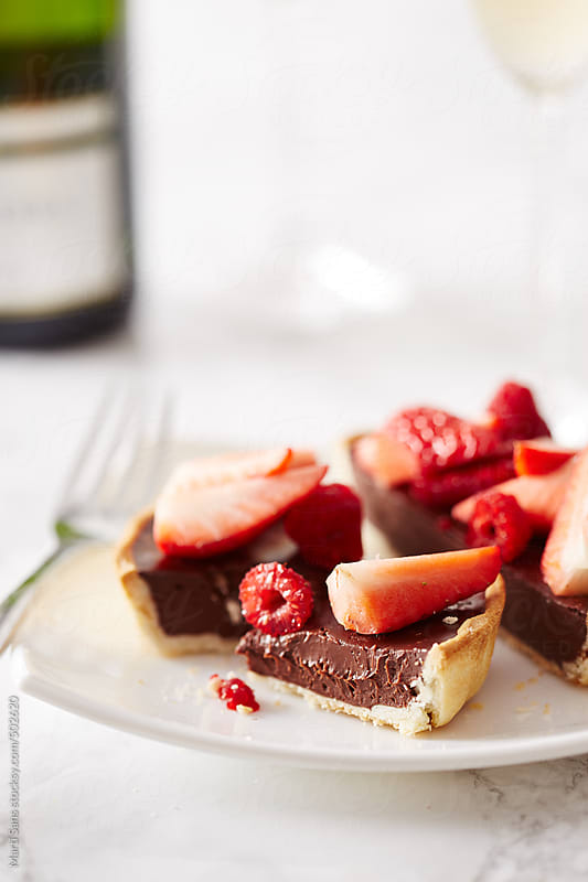 Chocolate and red berries tart by Martí Sans for Stocksy United