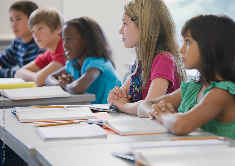 Children (8-9, 10-11, 12-13) in classroom by Andersen Ross Photography for Stocksy United