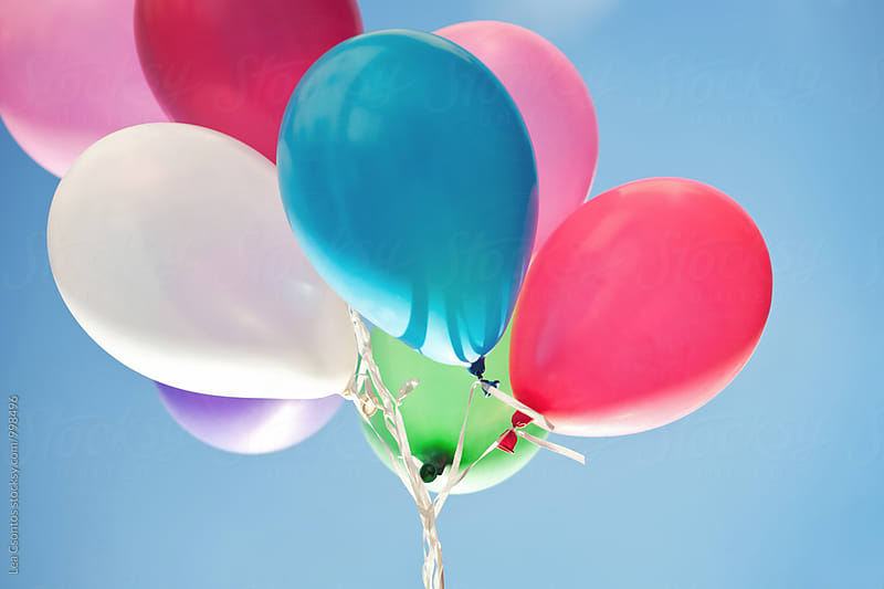 Colorful balloons against blue sky by Lea Csontos for Stocksy United